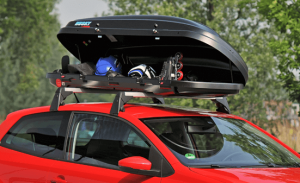 Filled roof box on top of a red car